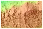 Impact Crater Exposing Bedrock in Thaumasia Planum