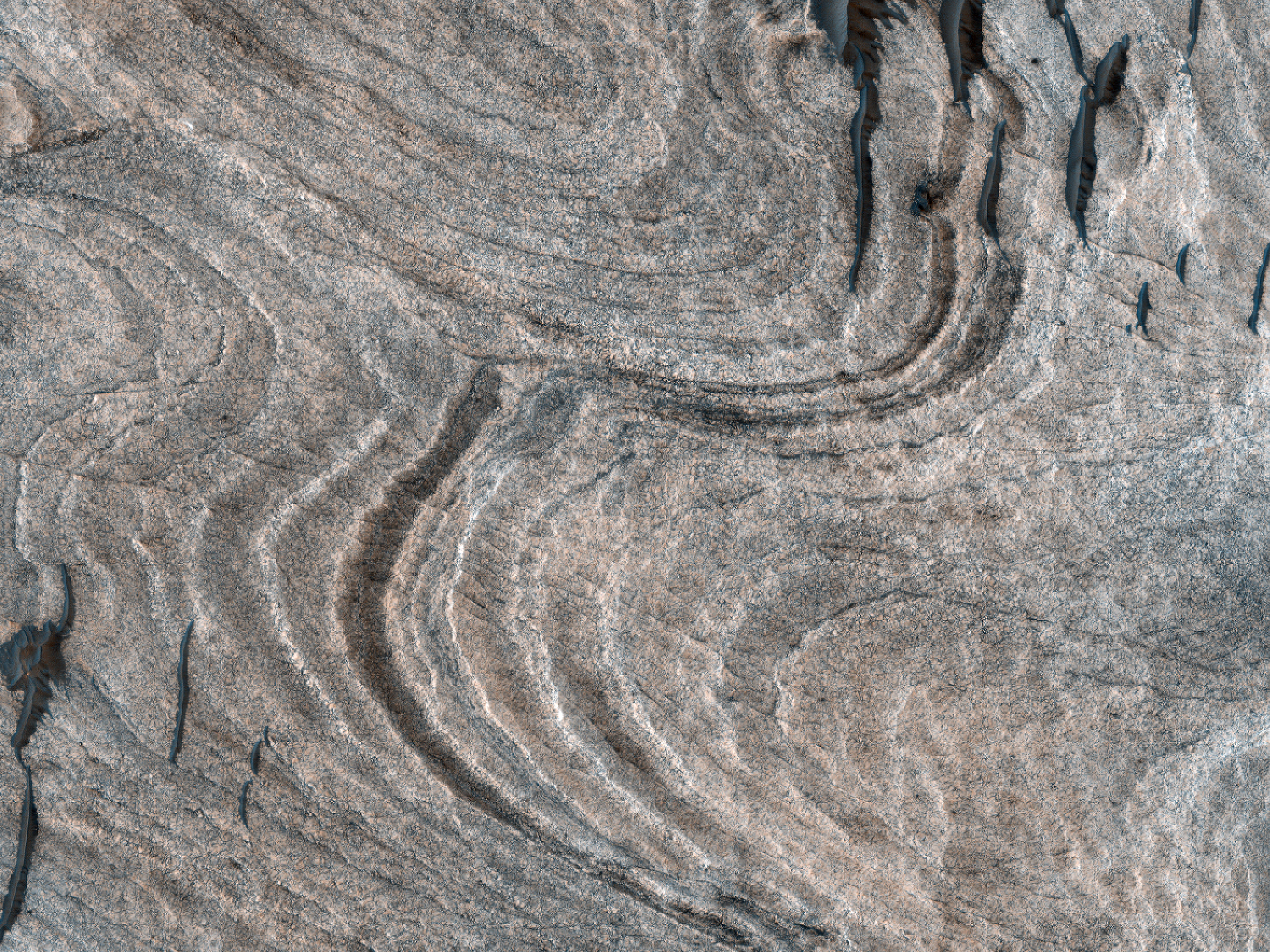 Differential Erosion of Light-Toned Stratigraphy in Melas Chasma