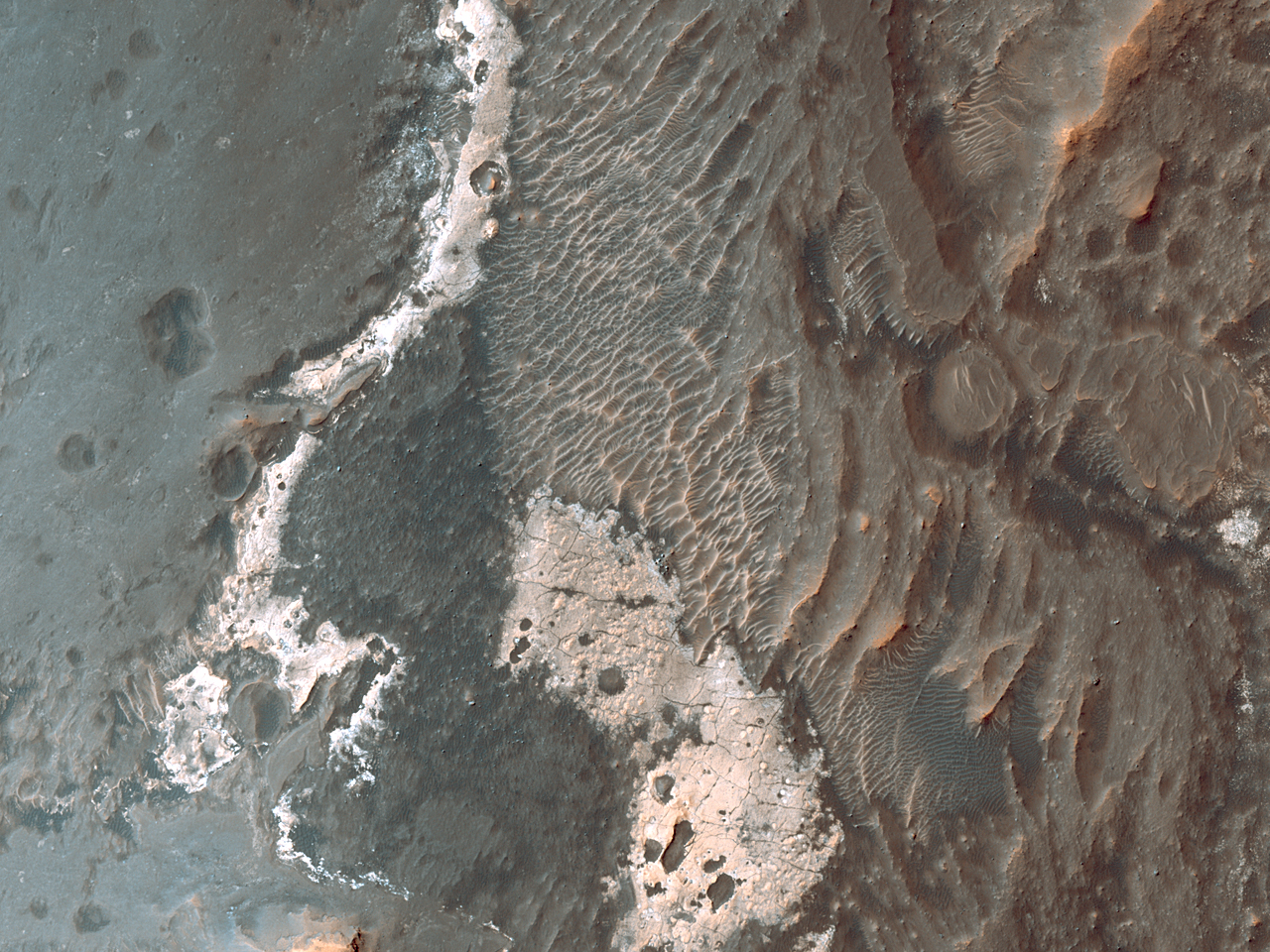 Light-Toned Material and Rough Terrain along Noctis Labyrinthus Pit