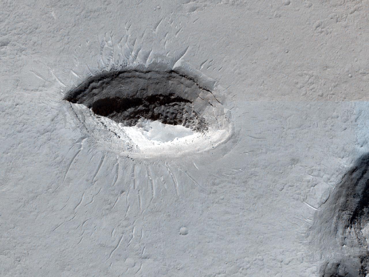 Terra inter crateres sita ad septentrionales et occidentem Crateris Crommelin