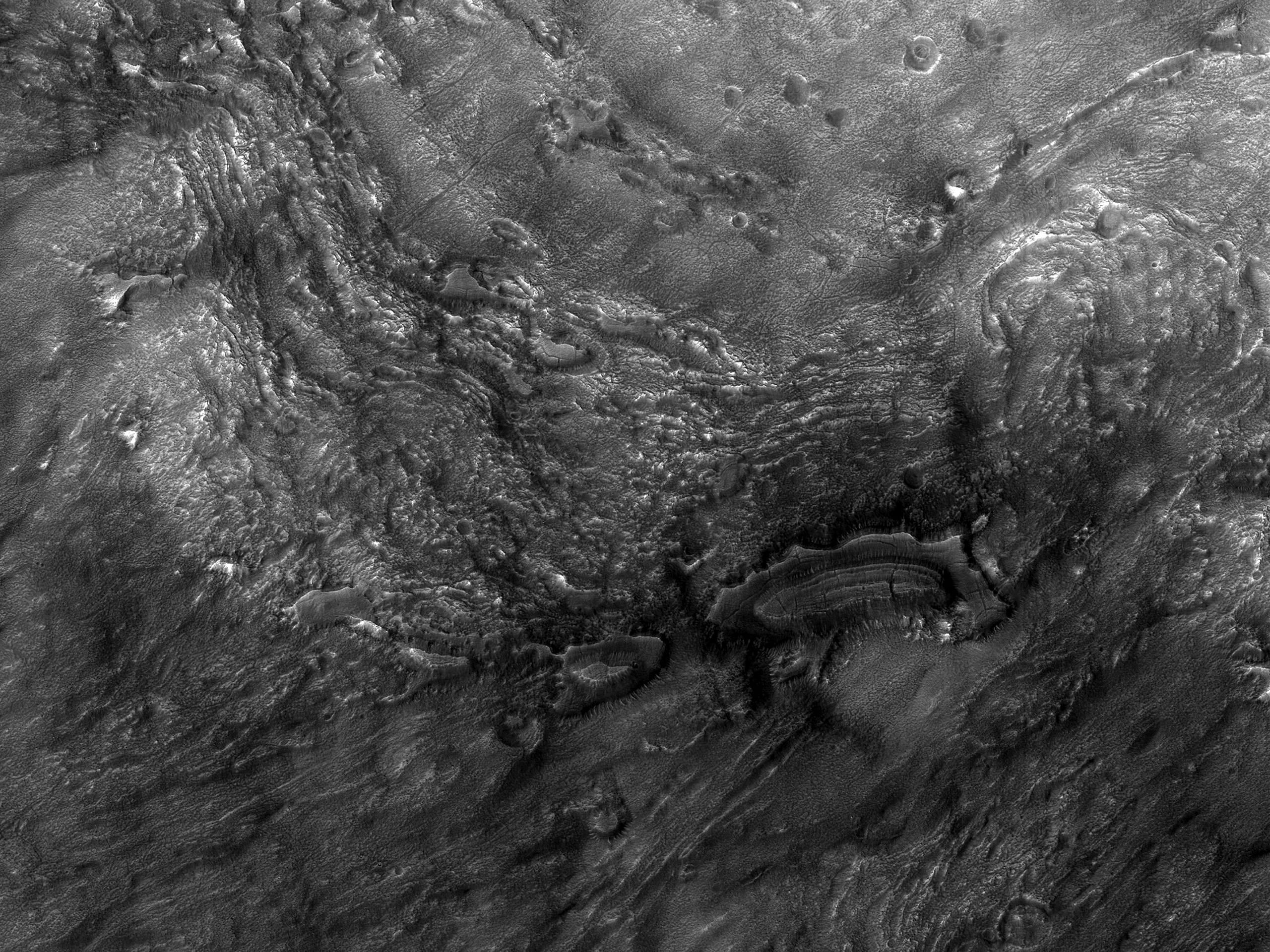 Crater Mounds in Ejecta in Deuteronilus Mensae