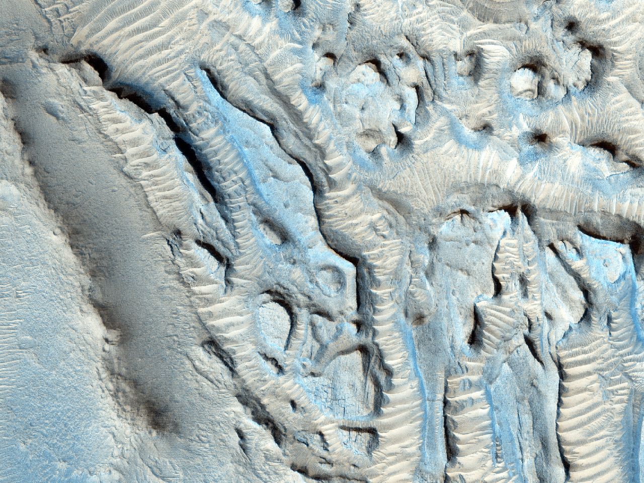 Small Channels and a Rocky Patch in the Cydonia Region