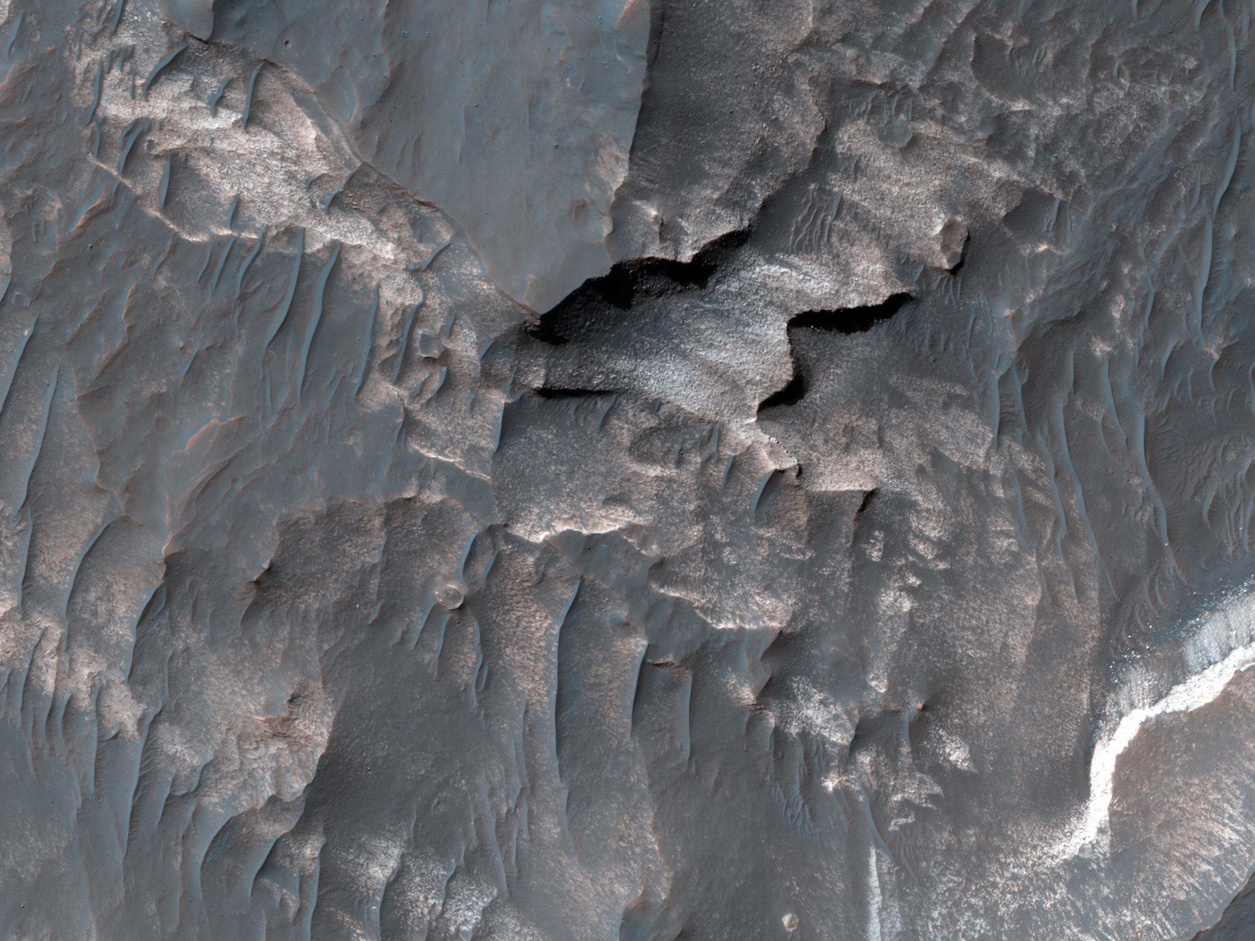 Light-Toned Deposits along Coprates Chasma Slopes