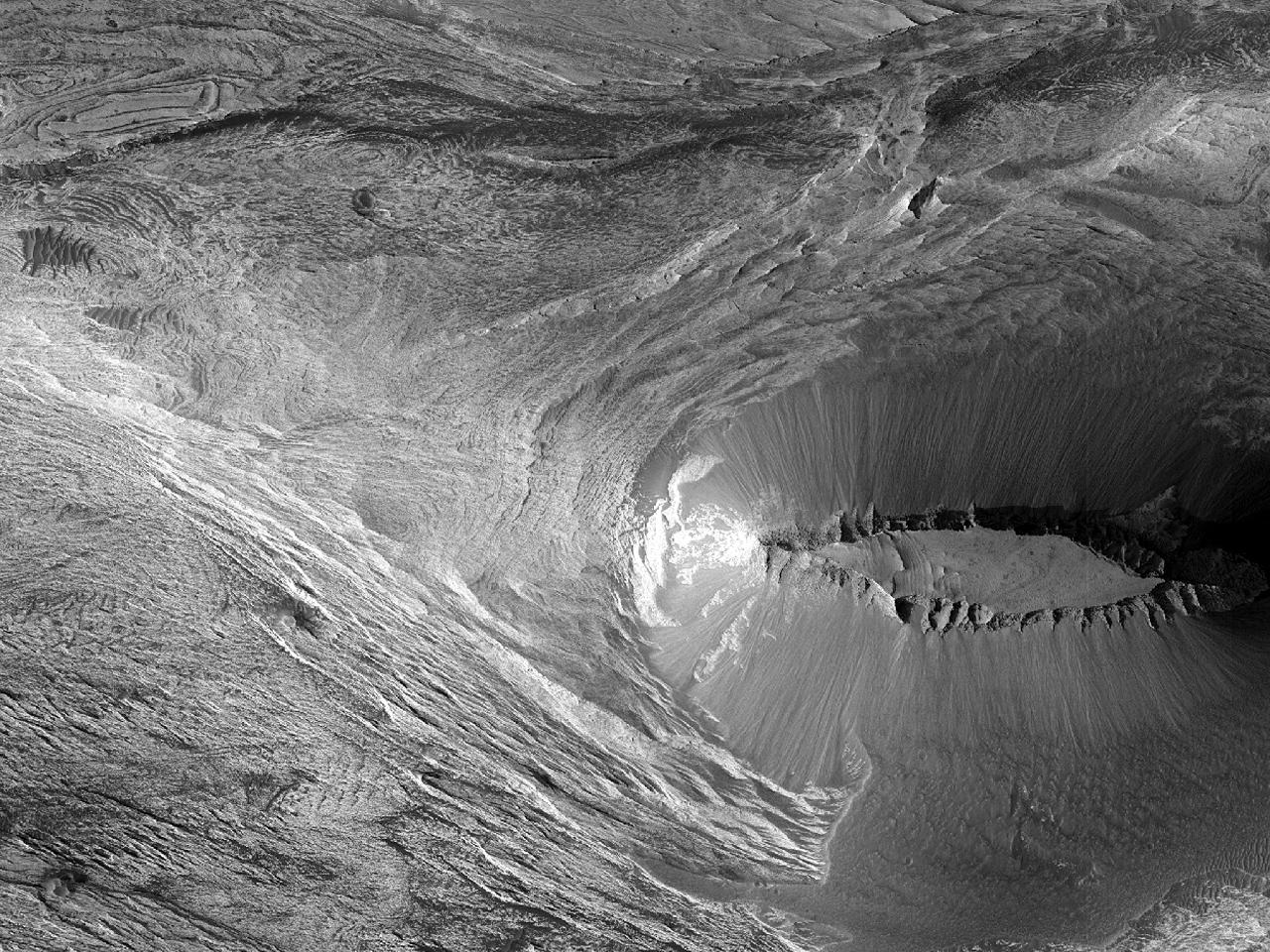 Tydelig Mesa med raviner i Candor Chasma