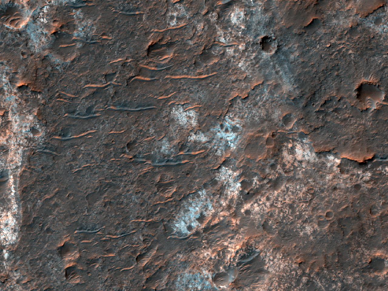 Предположительно, светлые слоистые силикаты земли Margaritifer Terra