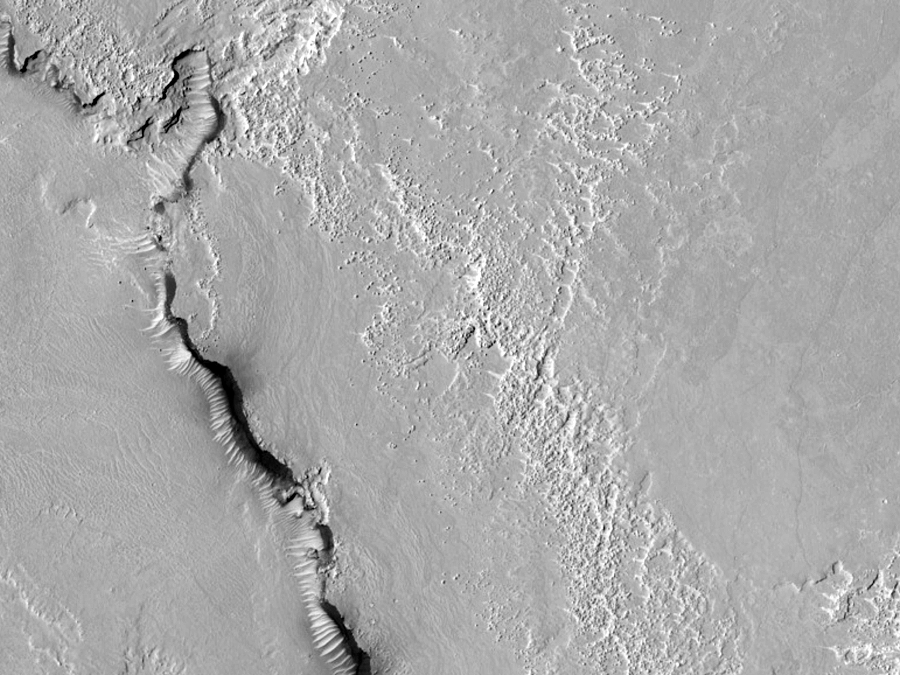 Curving Features at the Source of Athabasca Valles