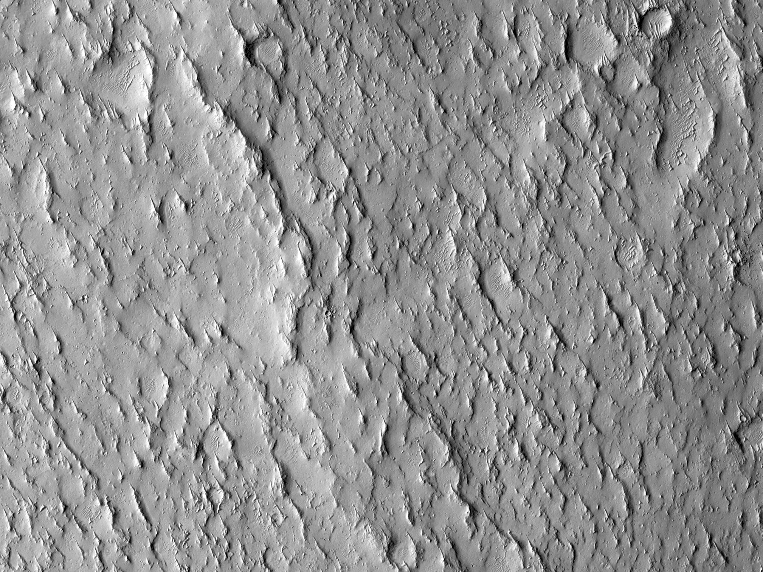 A Wrinkle Ridge in Crater Floor Material