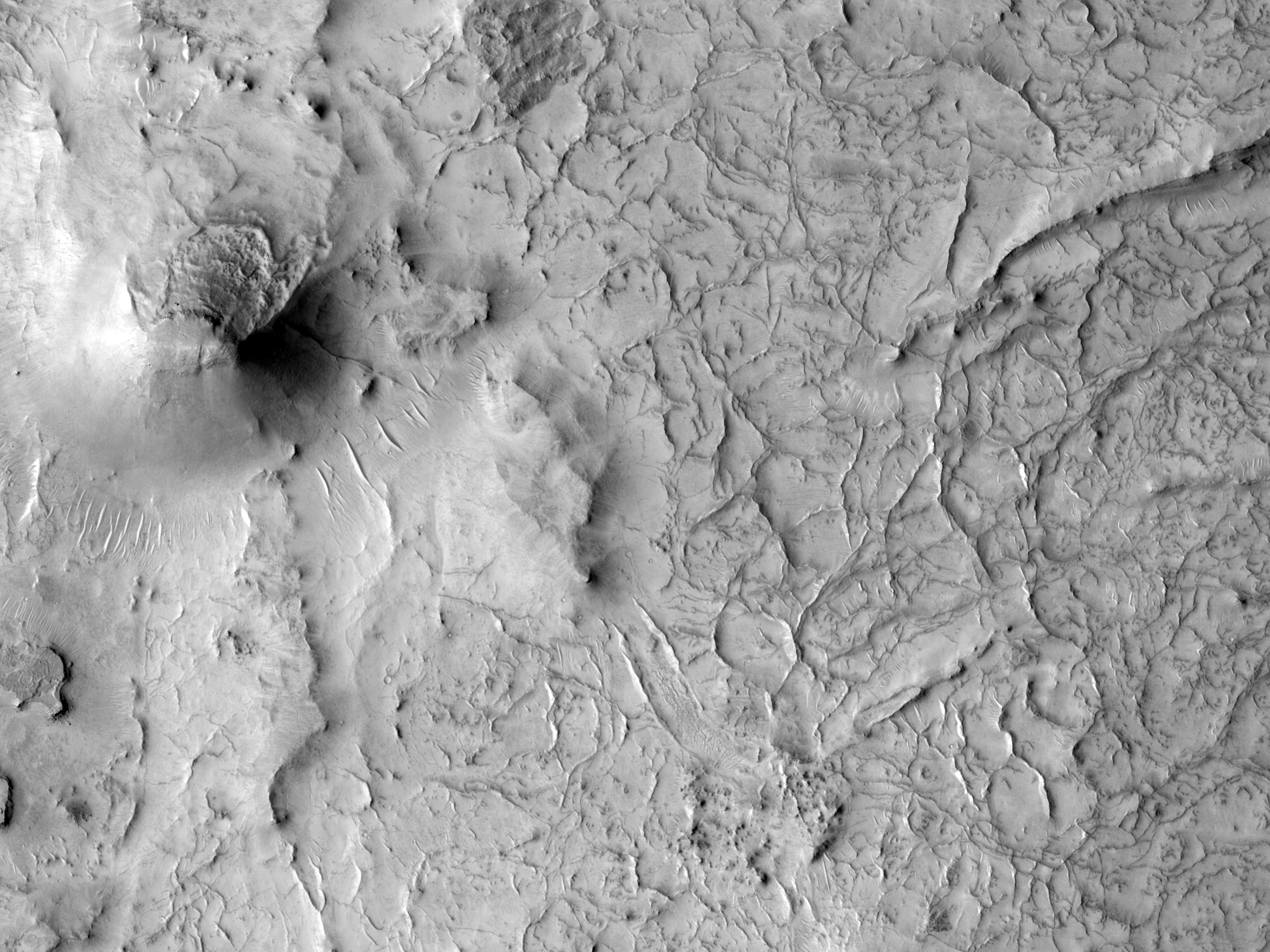 Layers and Ridges along Huo Hsing Vallis