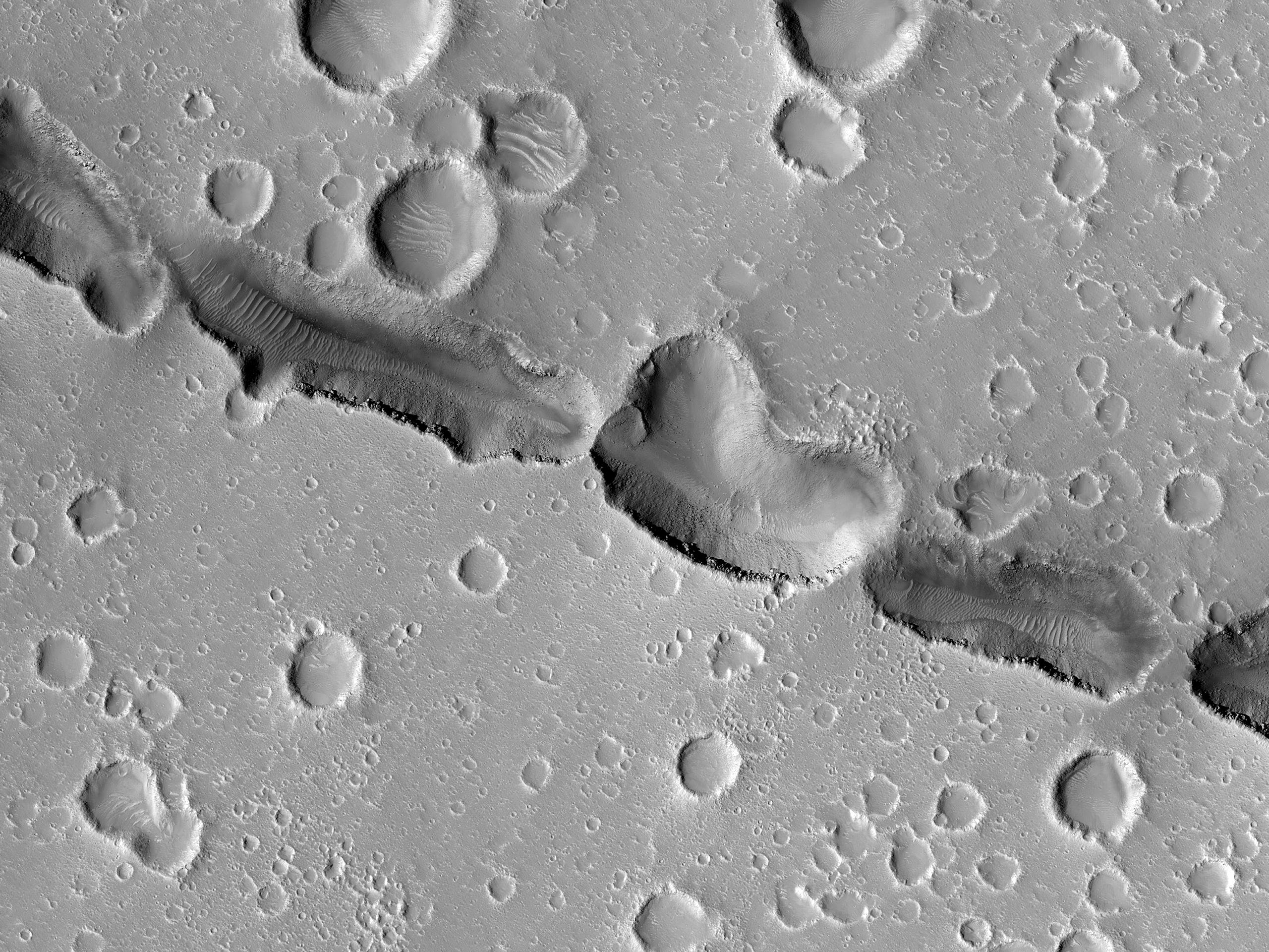 Hephaestus Fossae Pits