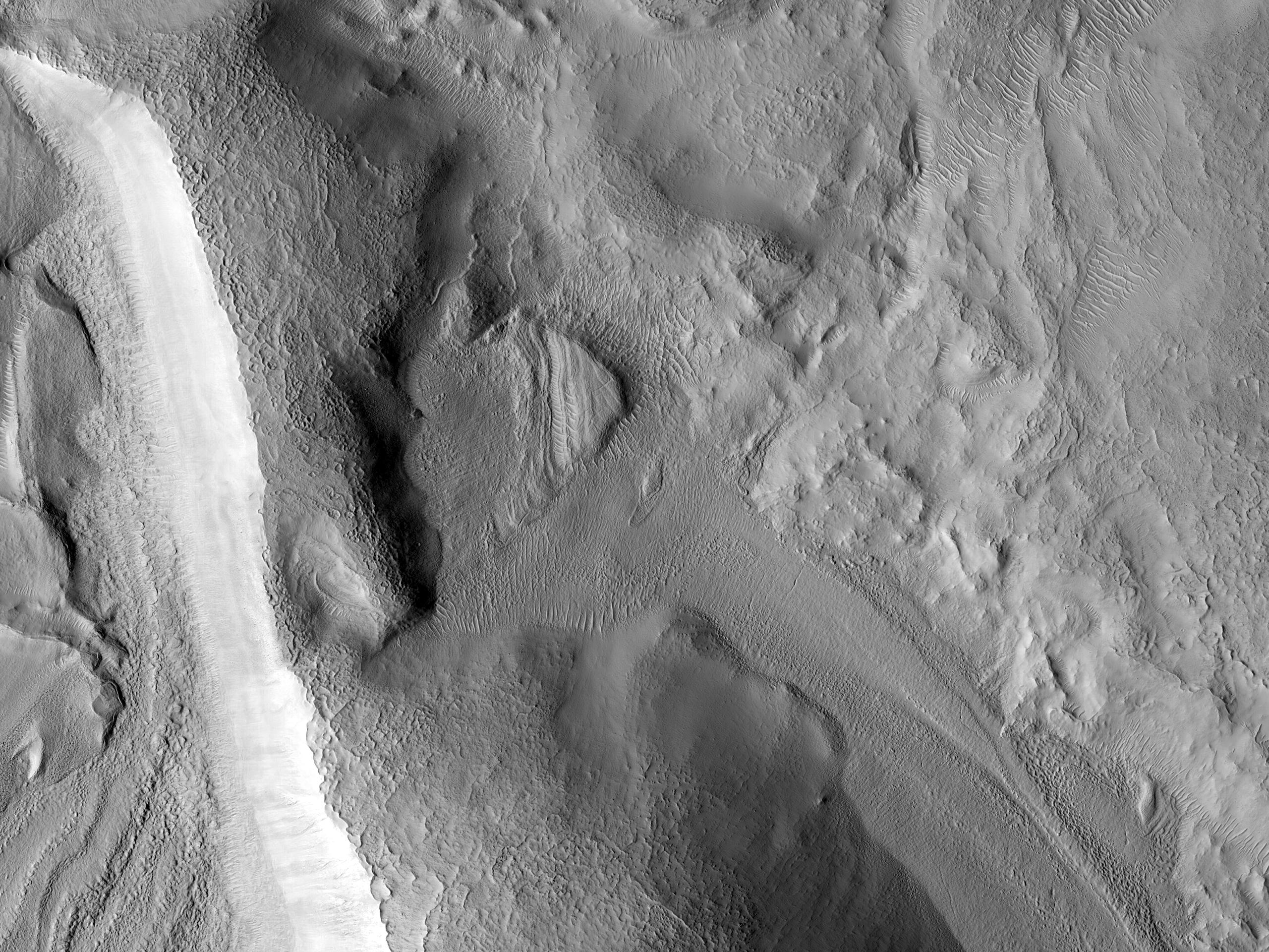 Flow Moving through Crater in Nilosyrtis Mensae