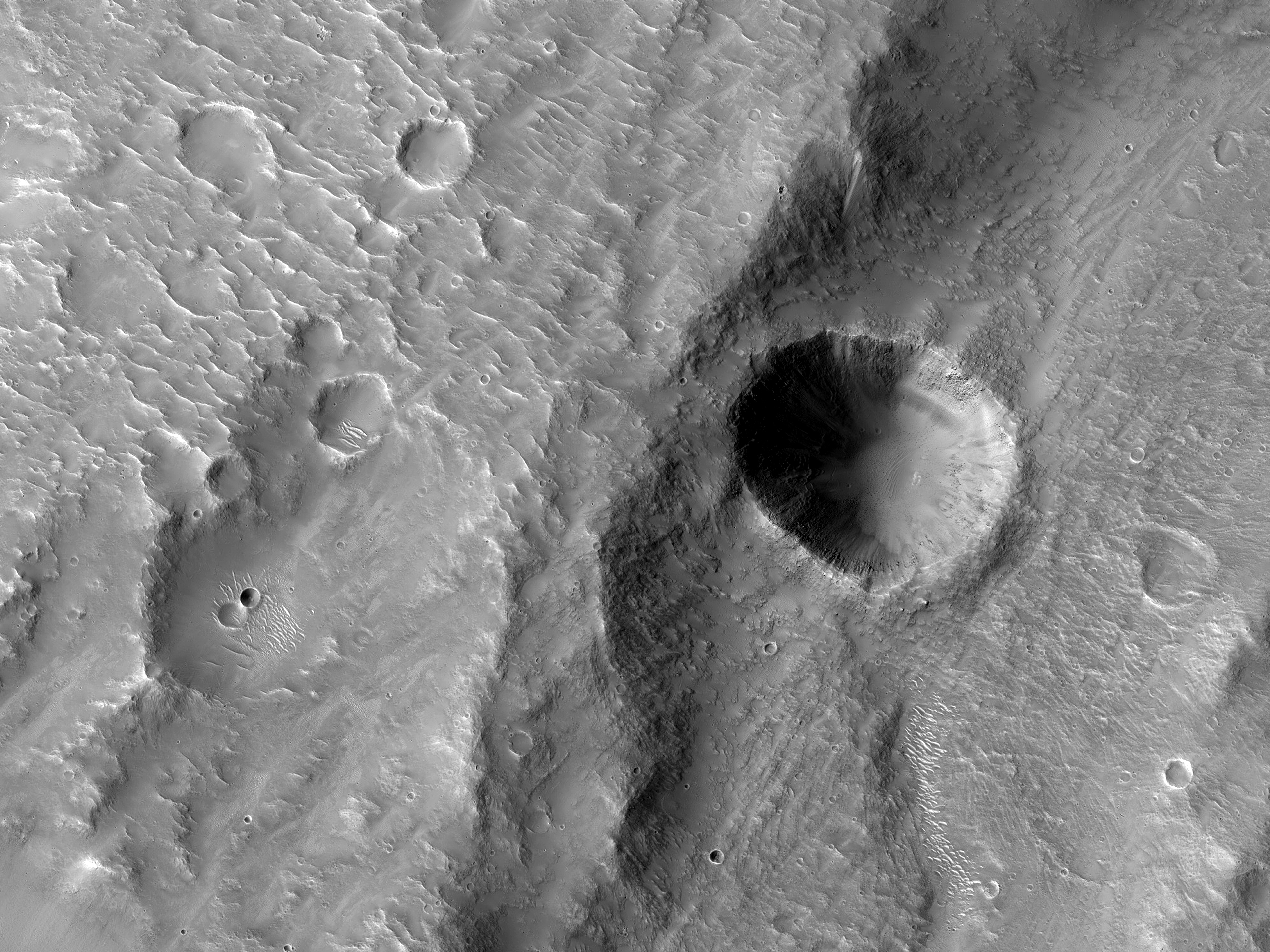 A Crater in the Inner Channel of Zarqa Valles