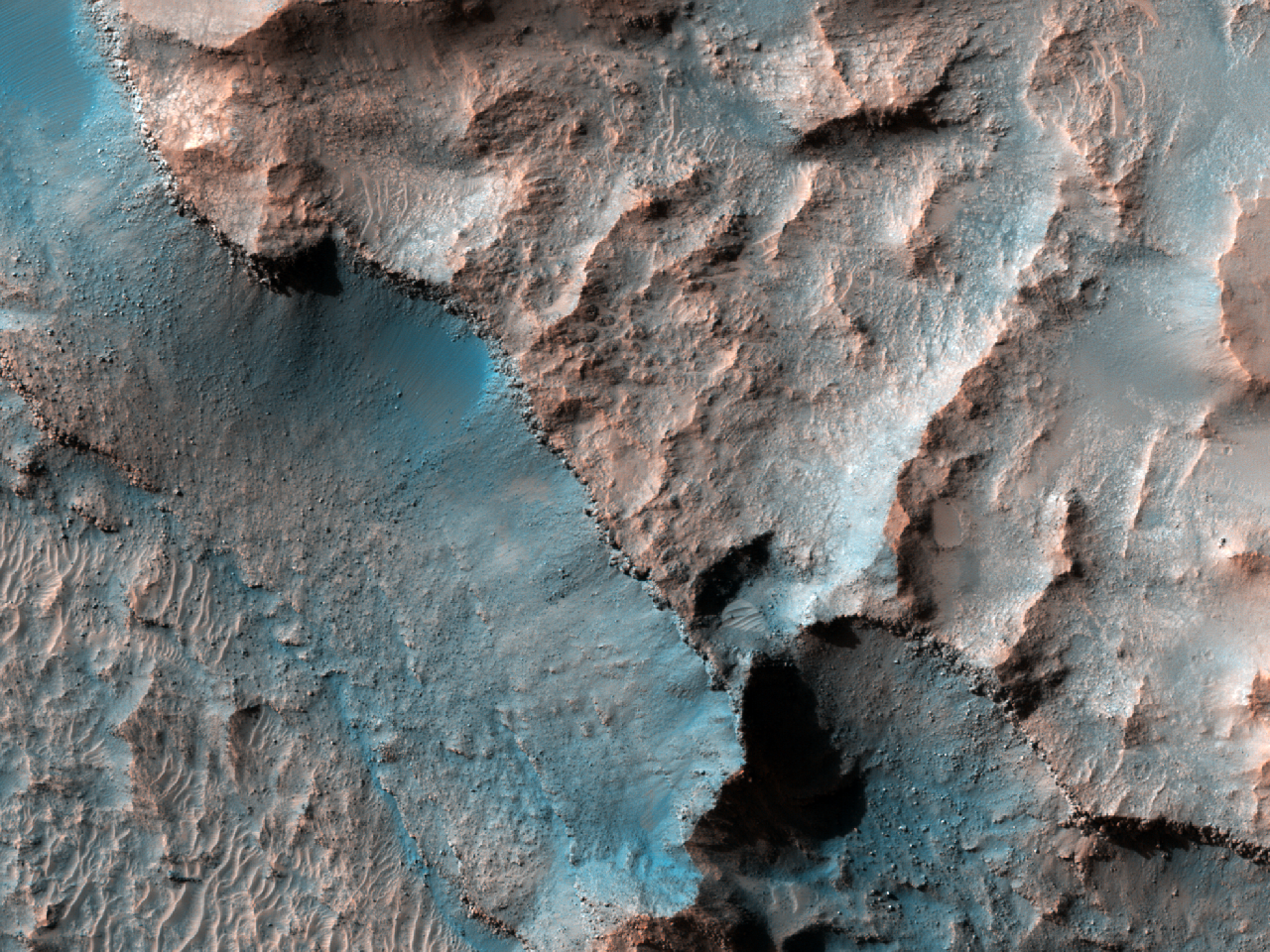 Pit on Crater Floor Exposing Layered Bedrock