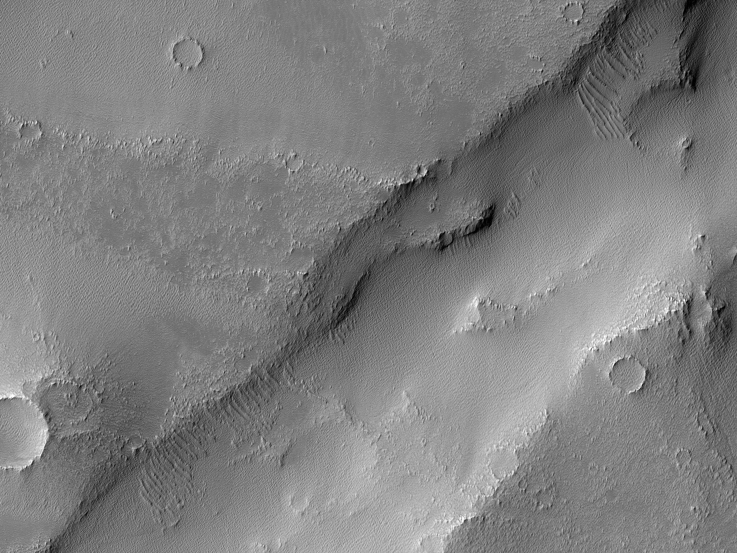 Lava Flow Moving into Trough in Claritas Fossae Region