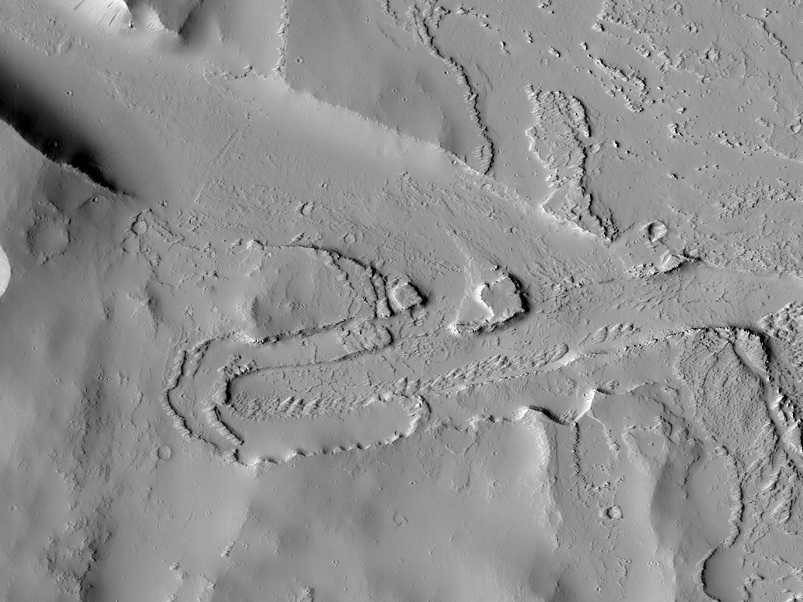 A Terraced Trough near Ceraunius Fossae