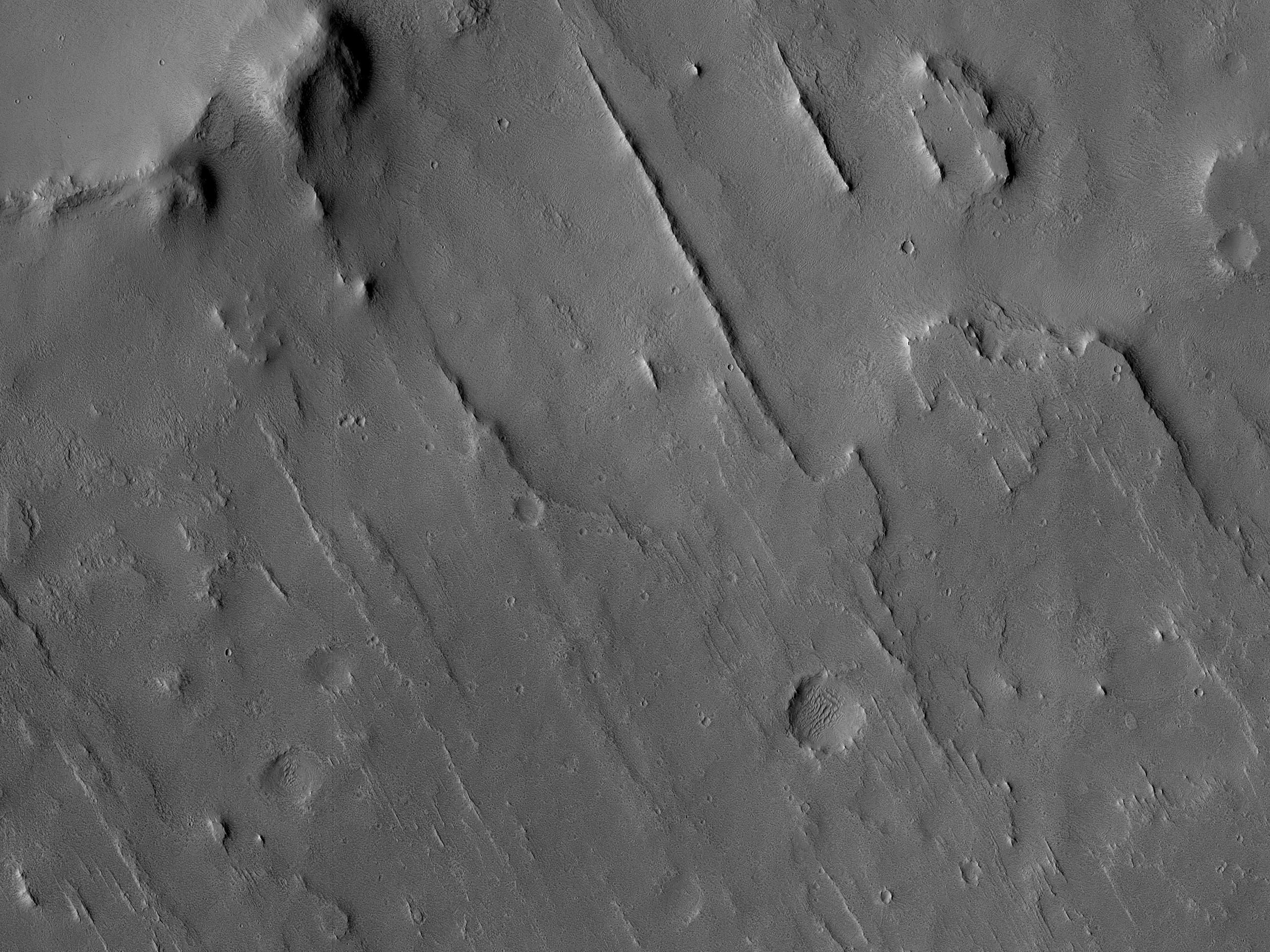 Straight Ridge-Forming Material South of Gill Crater in West Arabia Terra