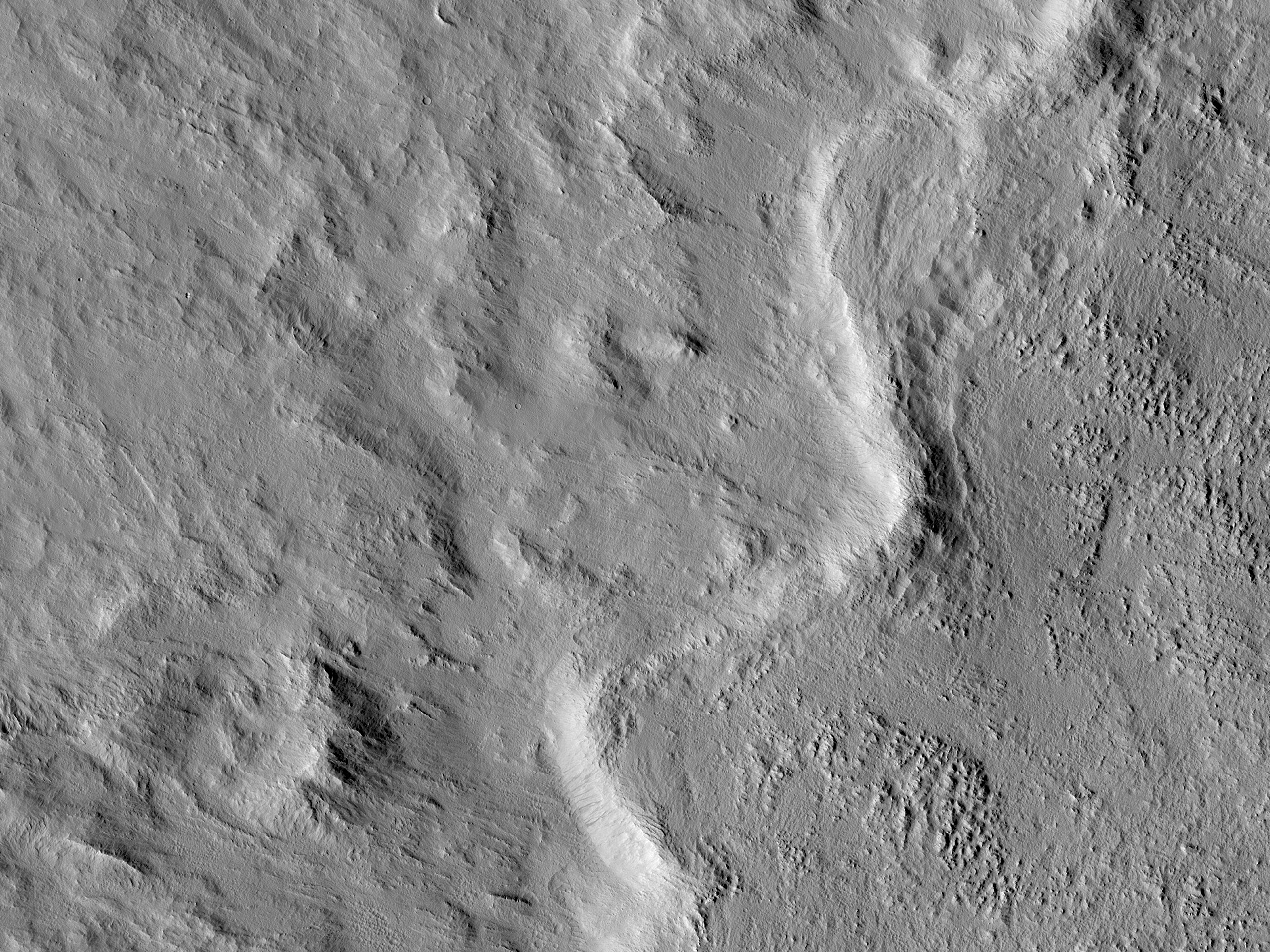 The Layered Ejecta of Canala Crater