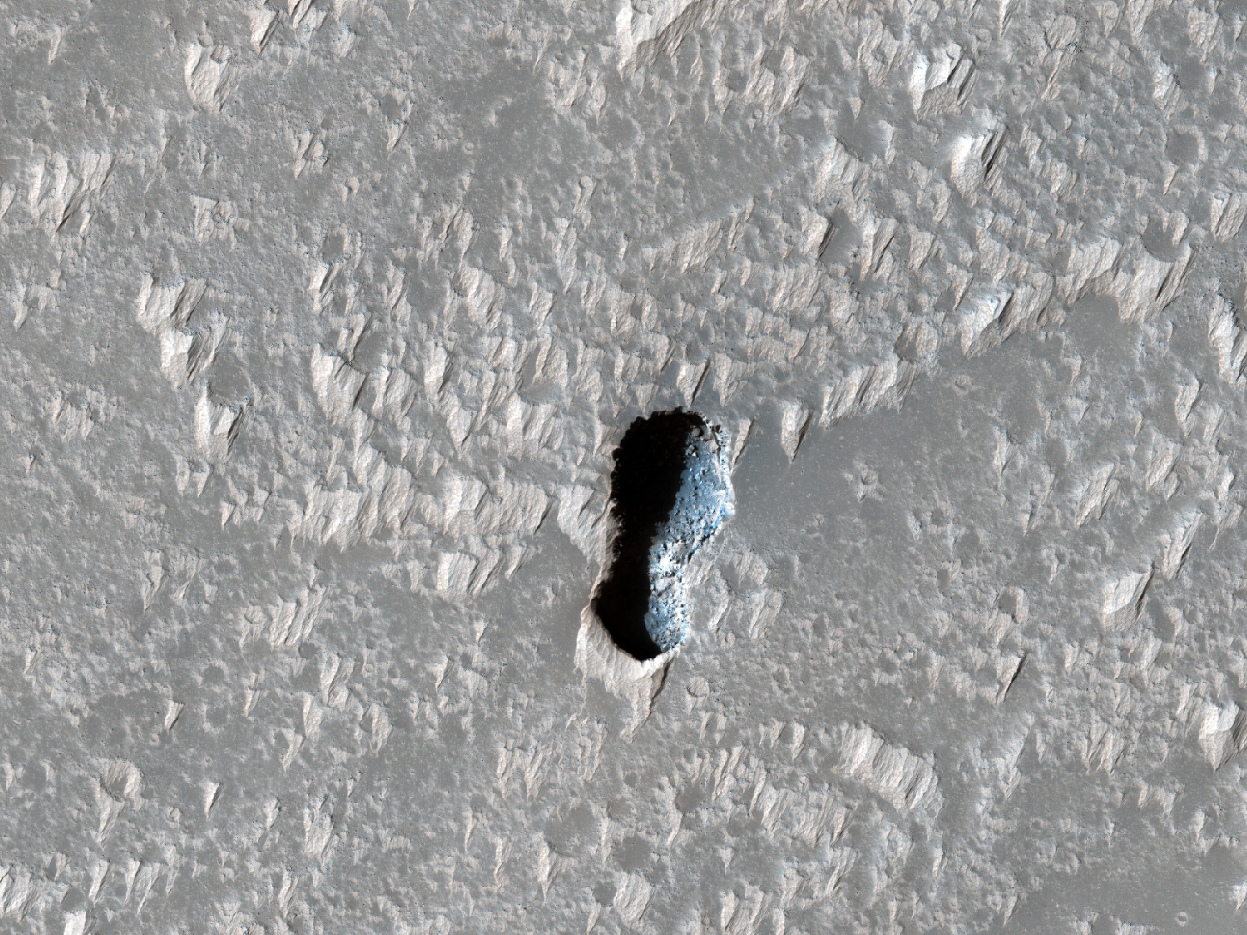 A Small Pit South of Arsia Mons