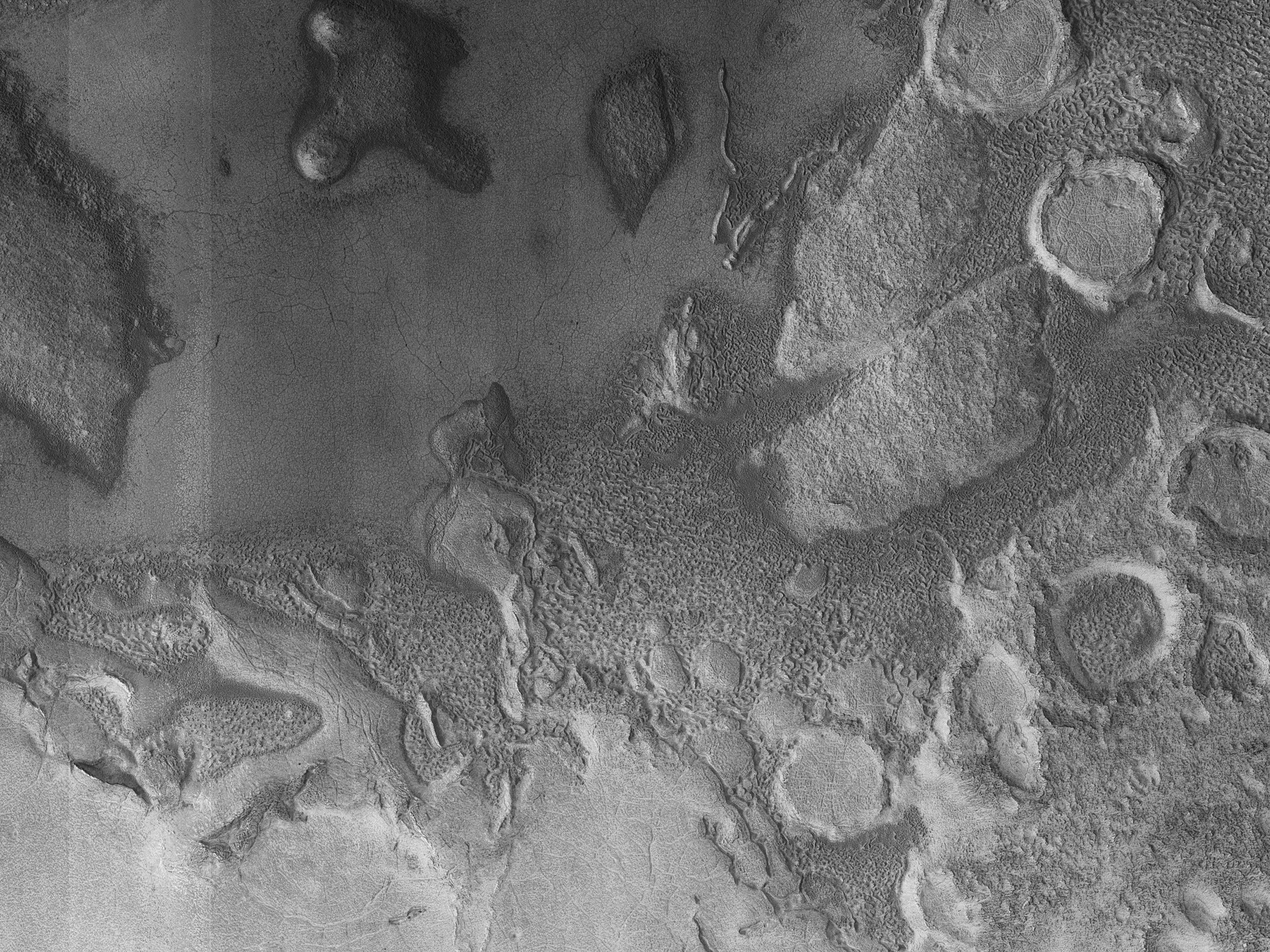 Erosion of Surfaces North of Moreux Crater