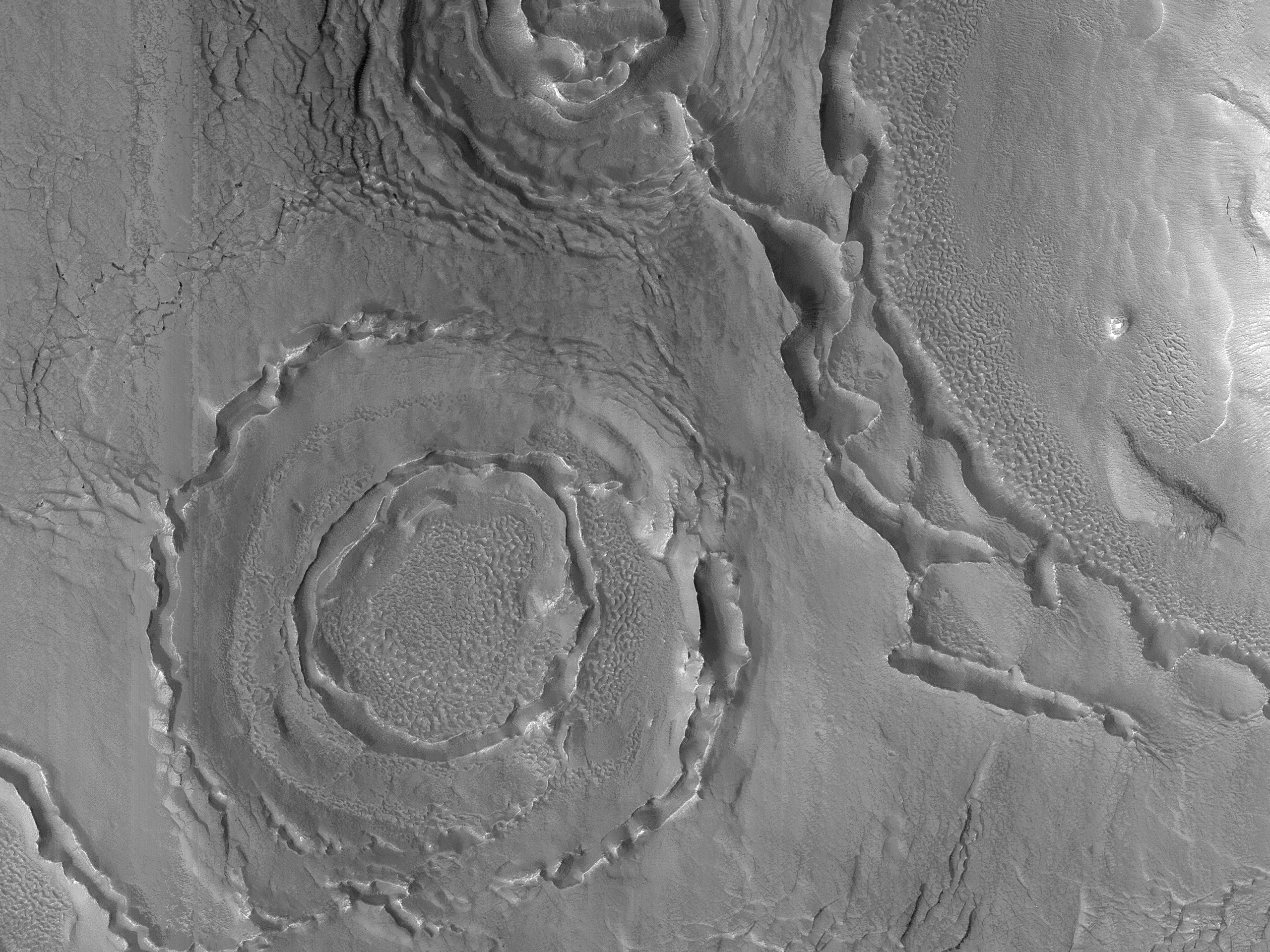 Ridges and Troughs in Circular Pattern in Deuteronilus Mensae