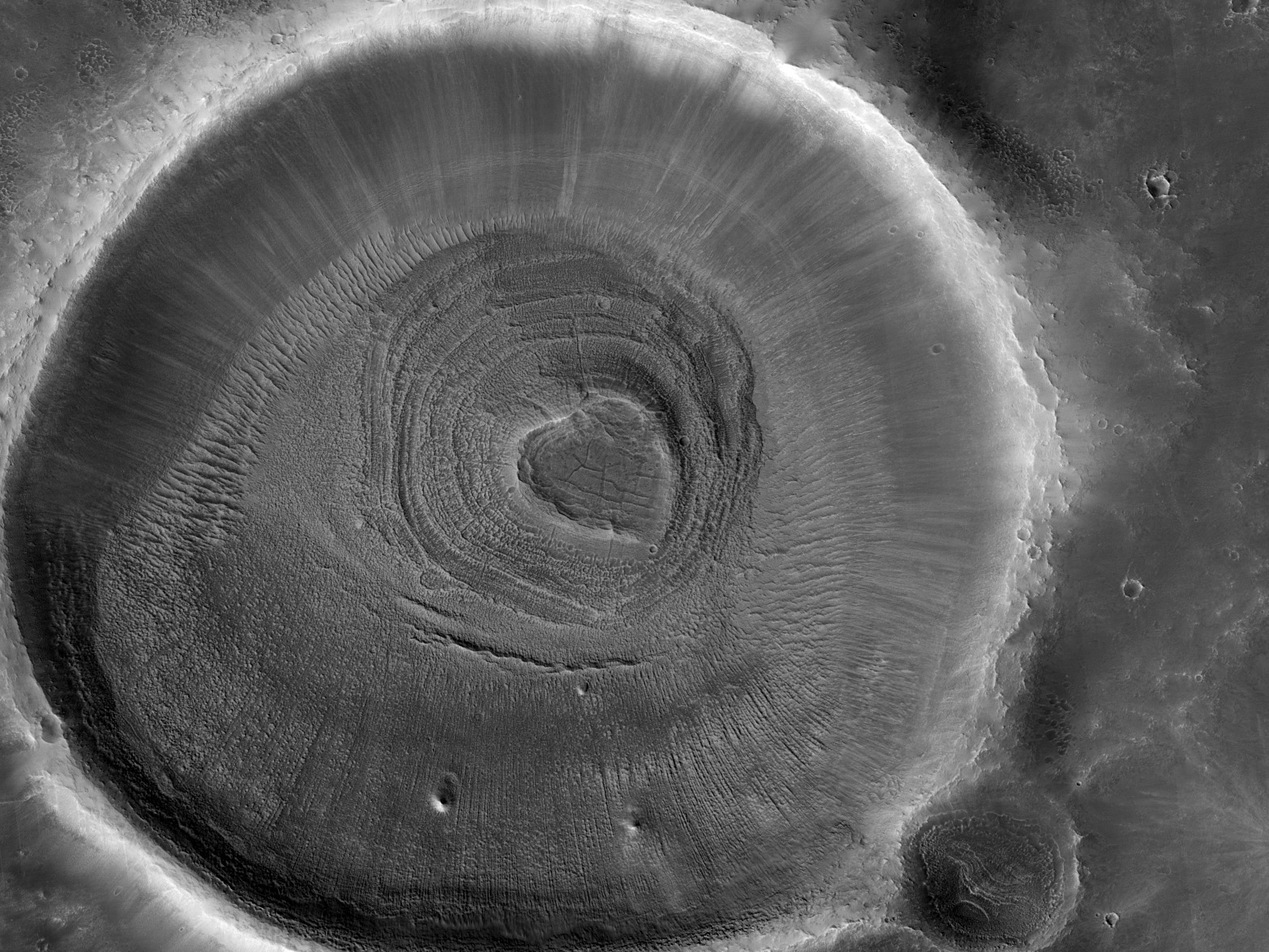 A Small Crater with a Layered Sedimentary Mound