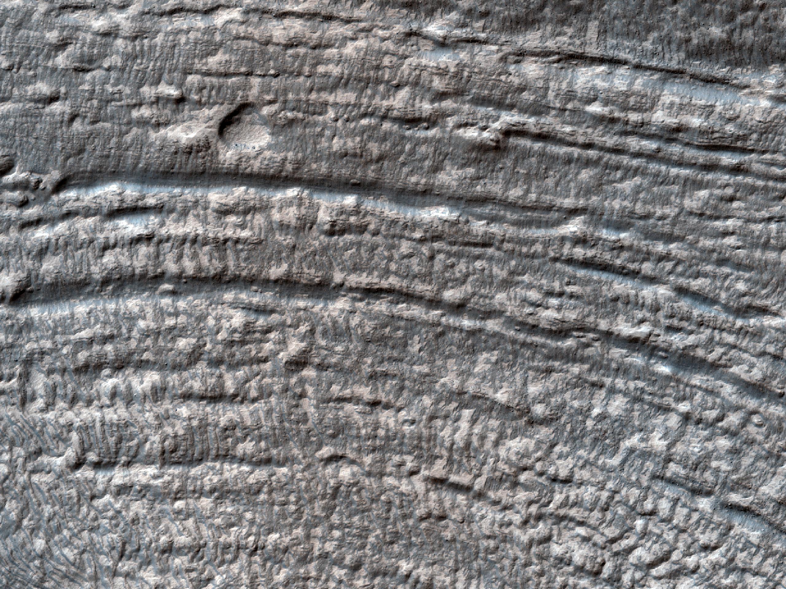 Debris Apron Material between Two Craters in Eastern Hellas Region