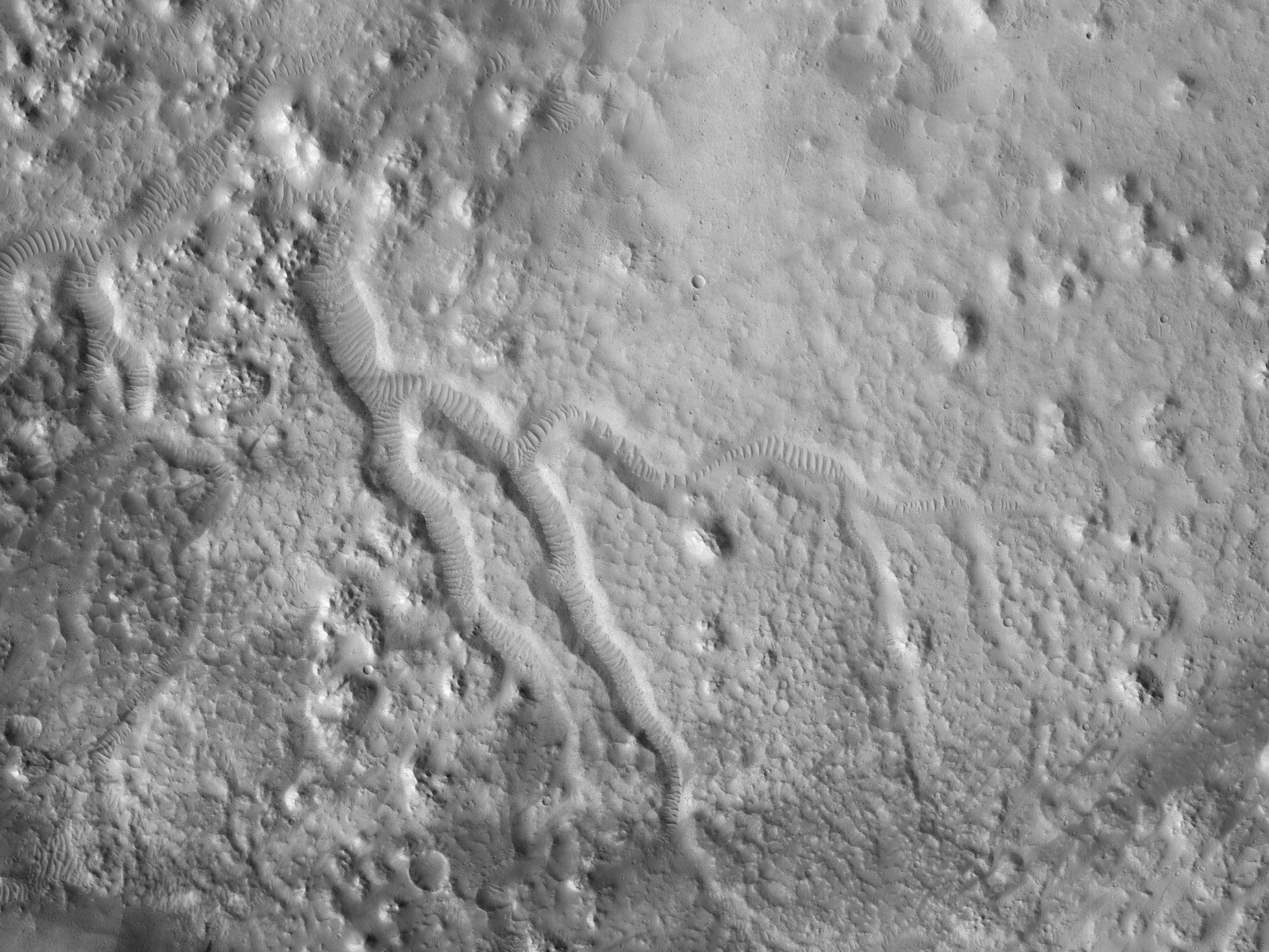 Valleys in a Crater to the North of Sacra Sulci