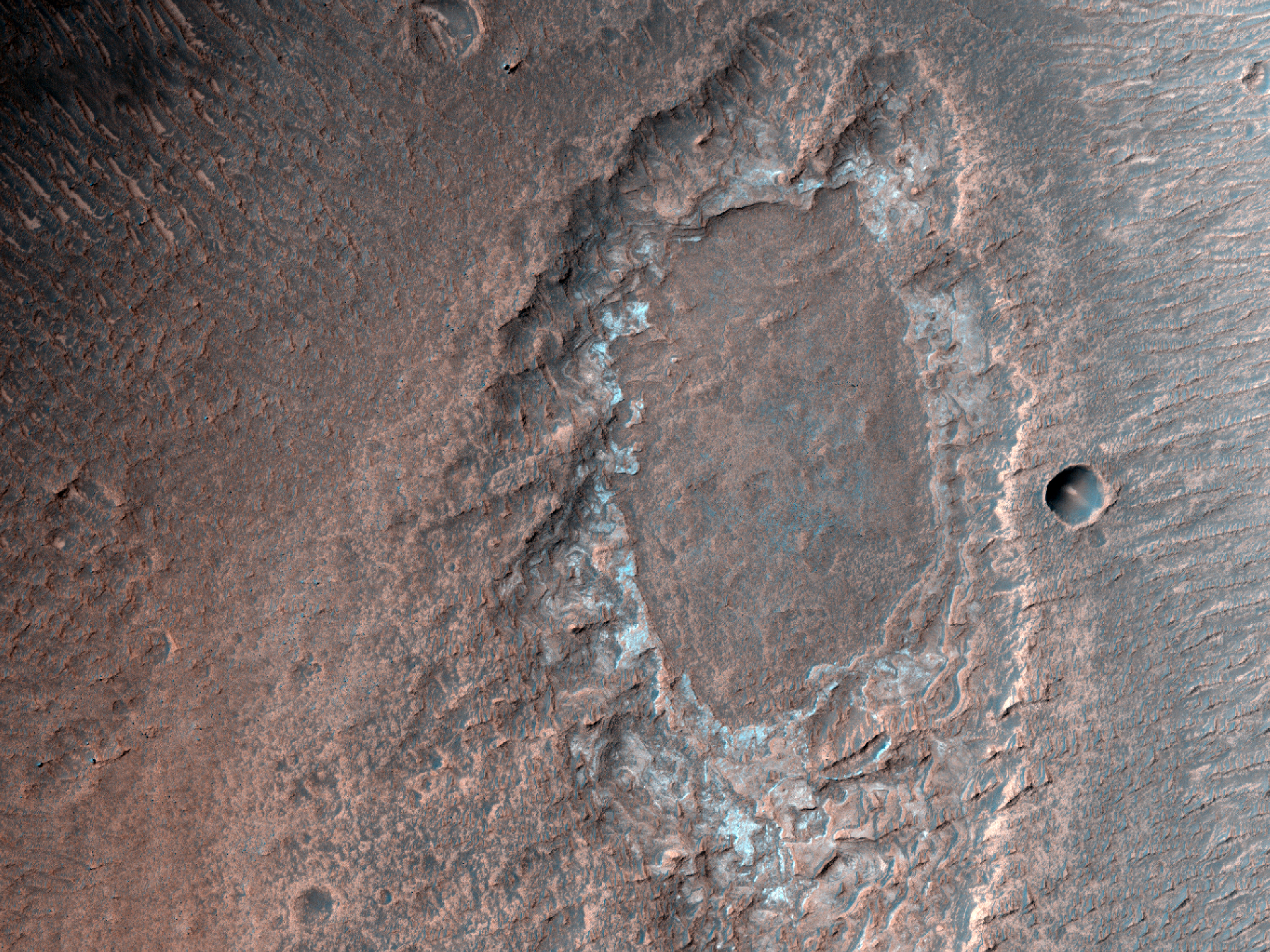 A Depression among Chaos in Juventae Chasma