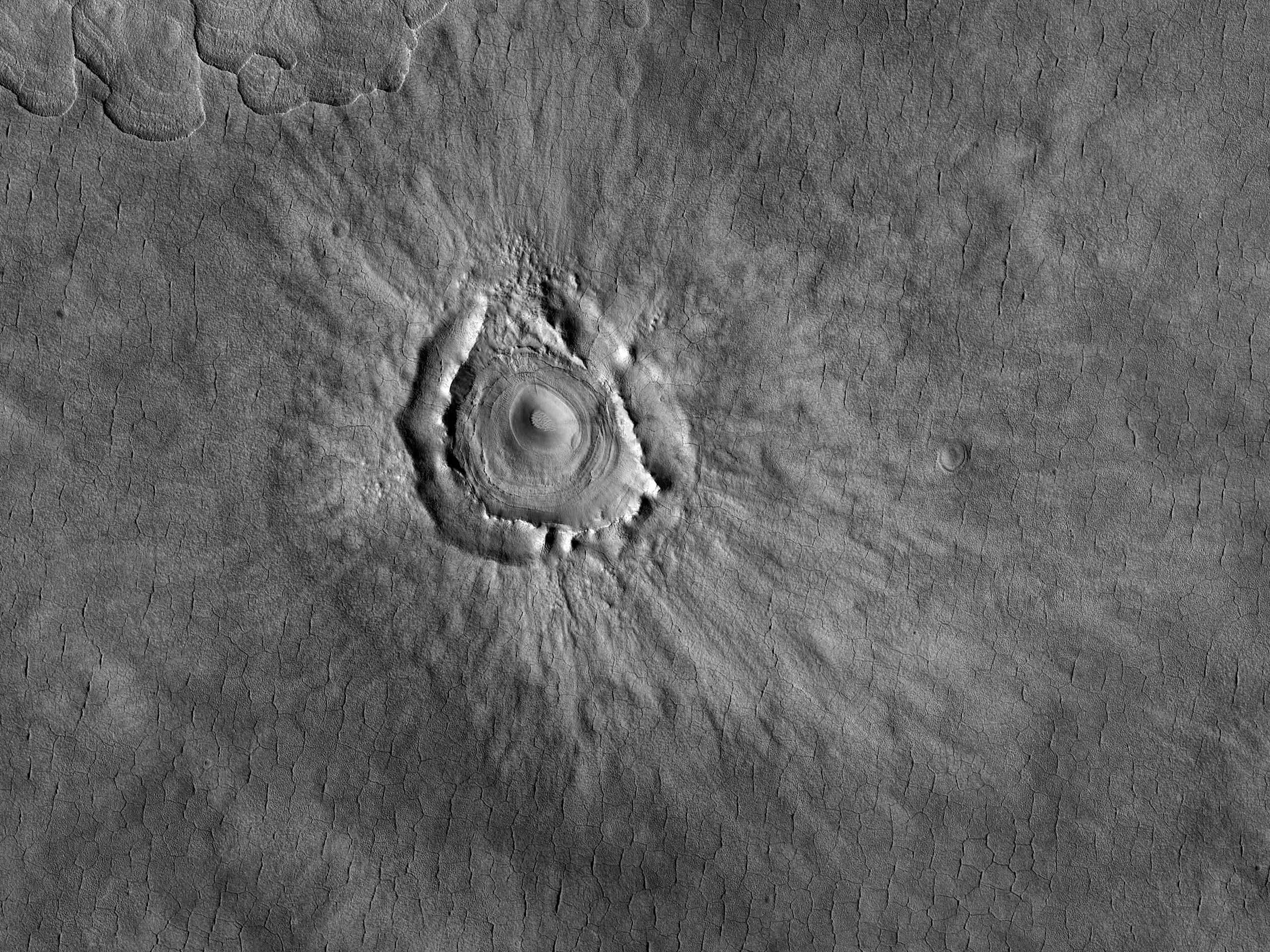 Deformovaný kráter v regionu Utopia Planitia