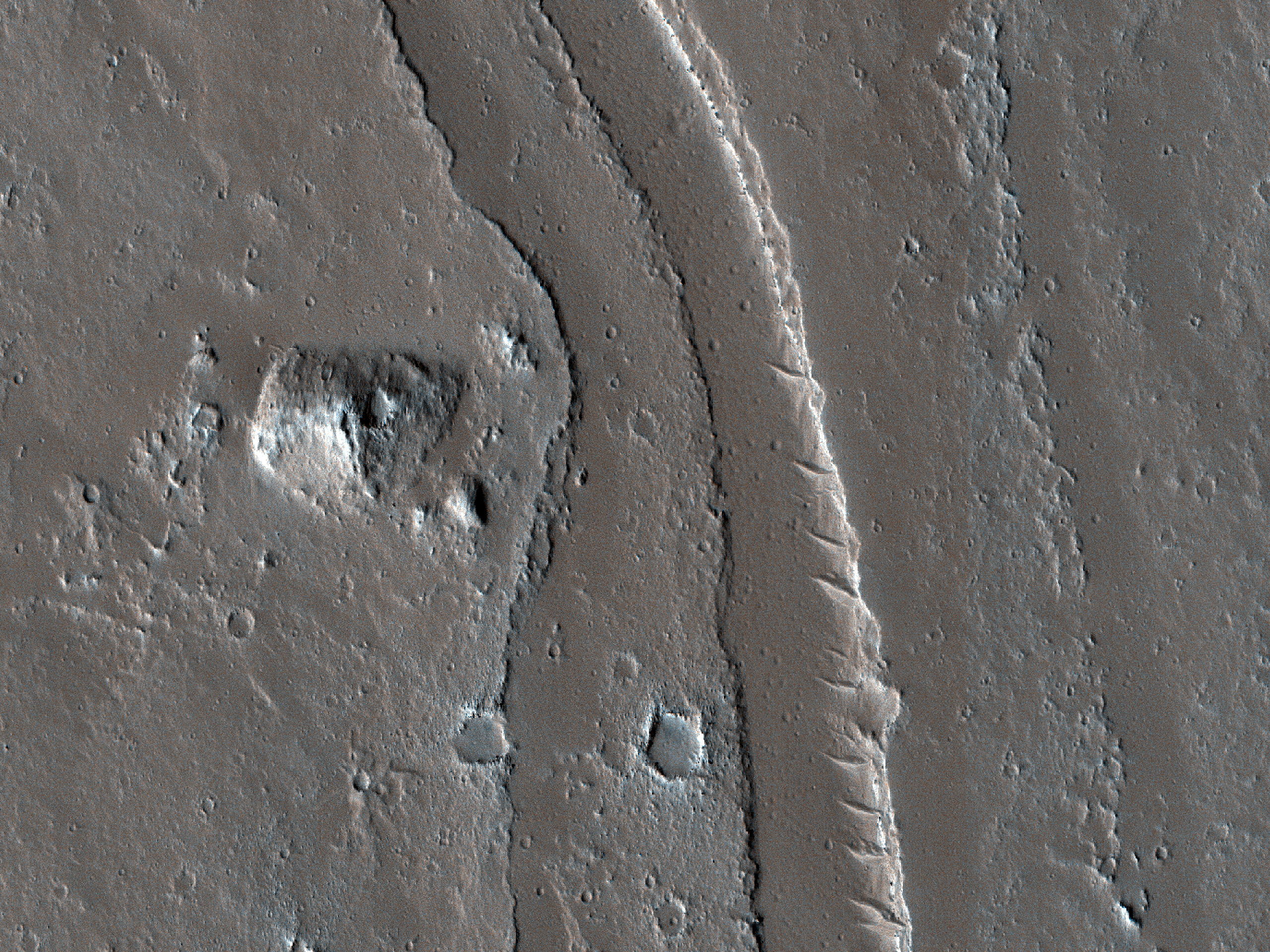 A Conical Feature near Channels and Fissures