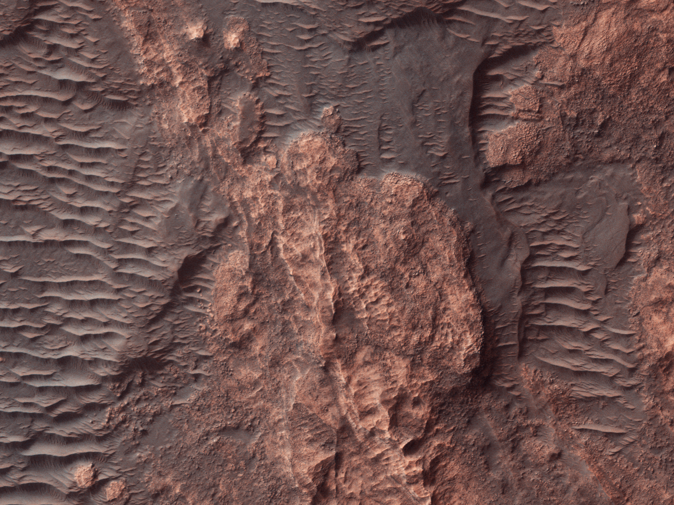 Rock Outcrops in a Southern Mid-Latitude Crater
