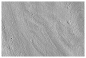 Fretted Terrain Valleys and Apron Materials