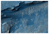 Evidence for Water and Wind Processes in Gale Crater