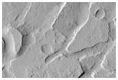 Troughs and Blocks on the Northern Edge of Lucus Planum
