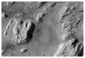 Layered Deposits in Crommlin Crater with Eroded Troughs