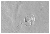 Low Shield with Elongate Summit Depression in North Tharsis