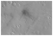 New Dark Spot Impact Crater