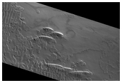 Swiss Cheese-Like Terrain Seen To Be Changing in MOC Imaging