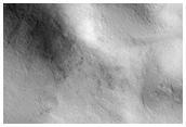 Spot Development Influenced by Underlying Terrain in Crater