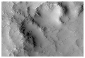 Breached Impact Crater in Memnonia
