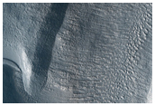 Possible Collapsed Slab Along Walls of Mamers Vallis