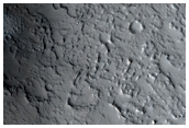 New Dark Spot and Potential New Impact Crater