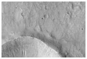 Bright Gully Deposit and Landslide in Terra Sirenum
