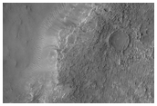 Odd Layered and Eroding Crater Fill in Deeply Eroded Craters
