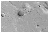 Low Shield with Radial Flows East of the Olympica Fossae