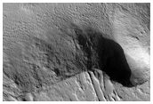 Possible Ice Sheet Cutout from Old Lava Flow in Olympus Mons Region