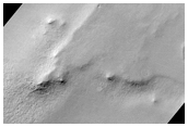 Knobs and Depressions in Malea Planum