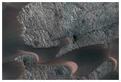 Region in Nili Patera with Bright and Dark Bedrock Exposures Between Dunes