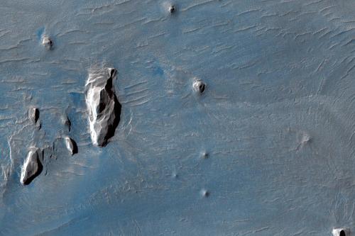 Dark Spot Near Olmpus Mons Volcano