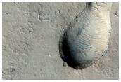Low Shield with Elongate Summit Caldera East of Olympica Fossae