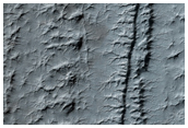 South Polar Layered Deposits Exposure with Fractures and Unconformities